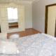 Спальня в апартаментах гостевого дома Агудзера