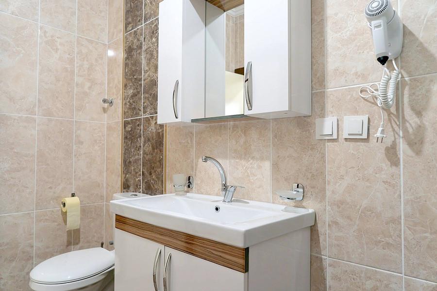 Туалетная комната в апартаментах гостевого дома Агудзера
