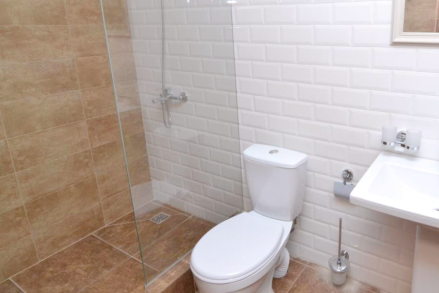 Туалетная комната в номере отеля Апра