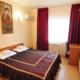 Стандарт четырехместный двухкомнатный отеля Бавария