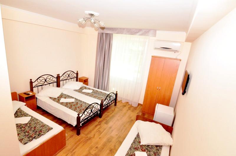 Стандартный четырехместный номер гостевого дома Белая панама