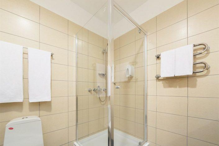 Туалетная комната трехкомнатного апартамента апарт-теля Бревис