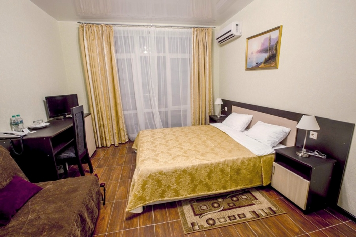 Семейный четырехместный двухкомнатный номер отеля Гранд Прибой