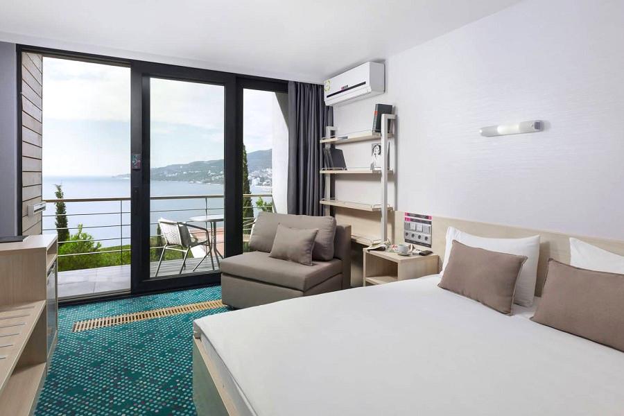 Улучшенный двухместный номер с двуспальной кроватью отеля Грин Парк