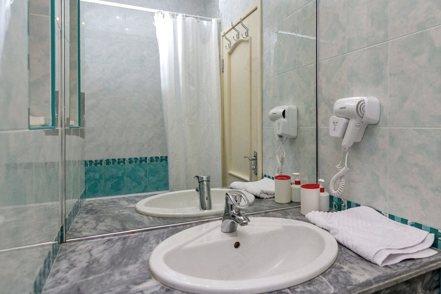 Туалетная комната в Апартаментах апарт-отеля Holiday