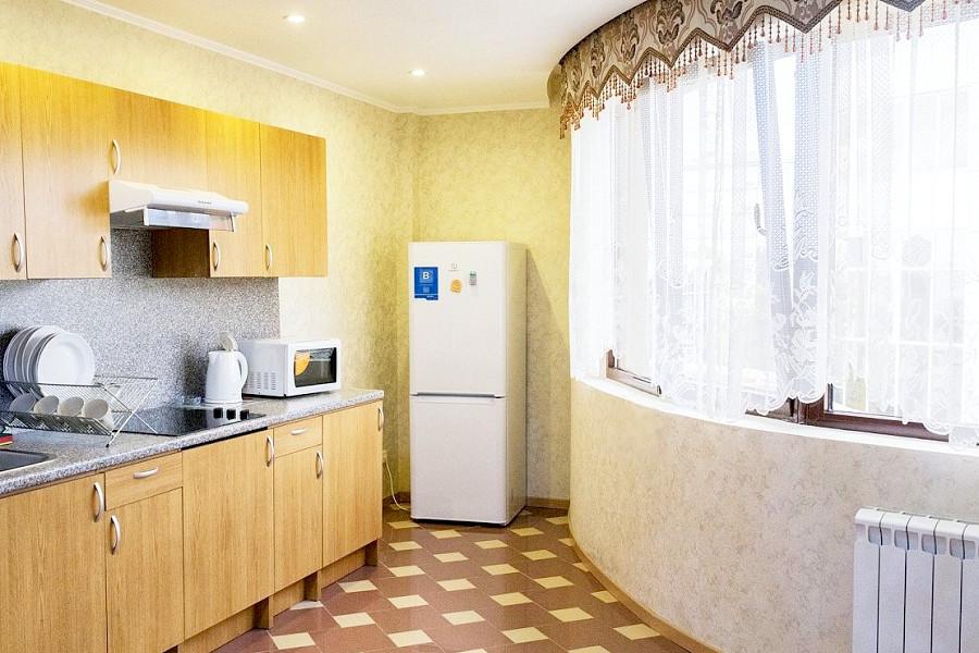 Апартаменты Премиум с кухней трехместные двухкомнатные апарт-отеля Holiday