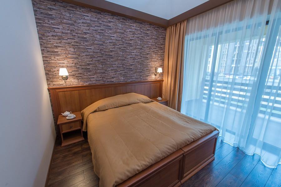 Спальня на втором этаже коттеджа отеля Mountain Villas