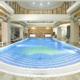 Бассейн в спа-комплексе отеля Palmira Palace