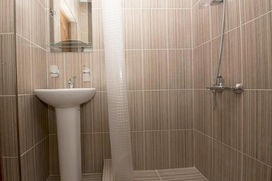 Туалетная комната в номере отеля Парадайз