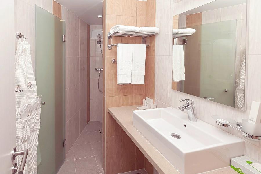 Туалетная комната номера Стандарт в отеле Спутник