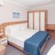 Стандарт Семейный четырехместный двухкомнатный отеля Спутник