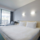 Улучшенный с двуспальной кроватью и креслом в отеле Ялта-Интурист