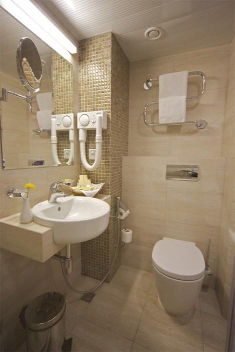 Ванная комната в номере Стандарт Премиум гранд-отеля Жемчужина
